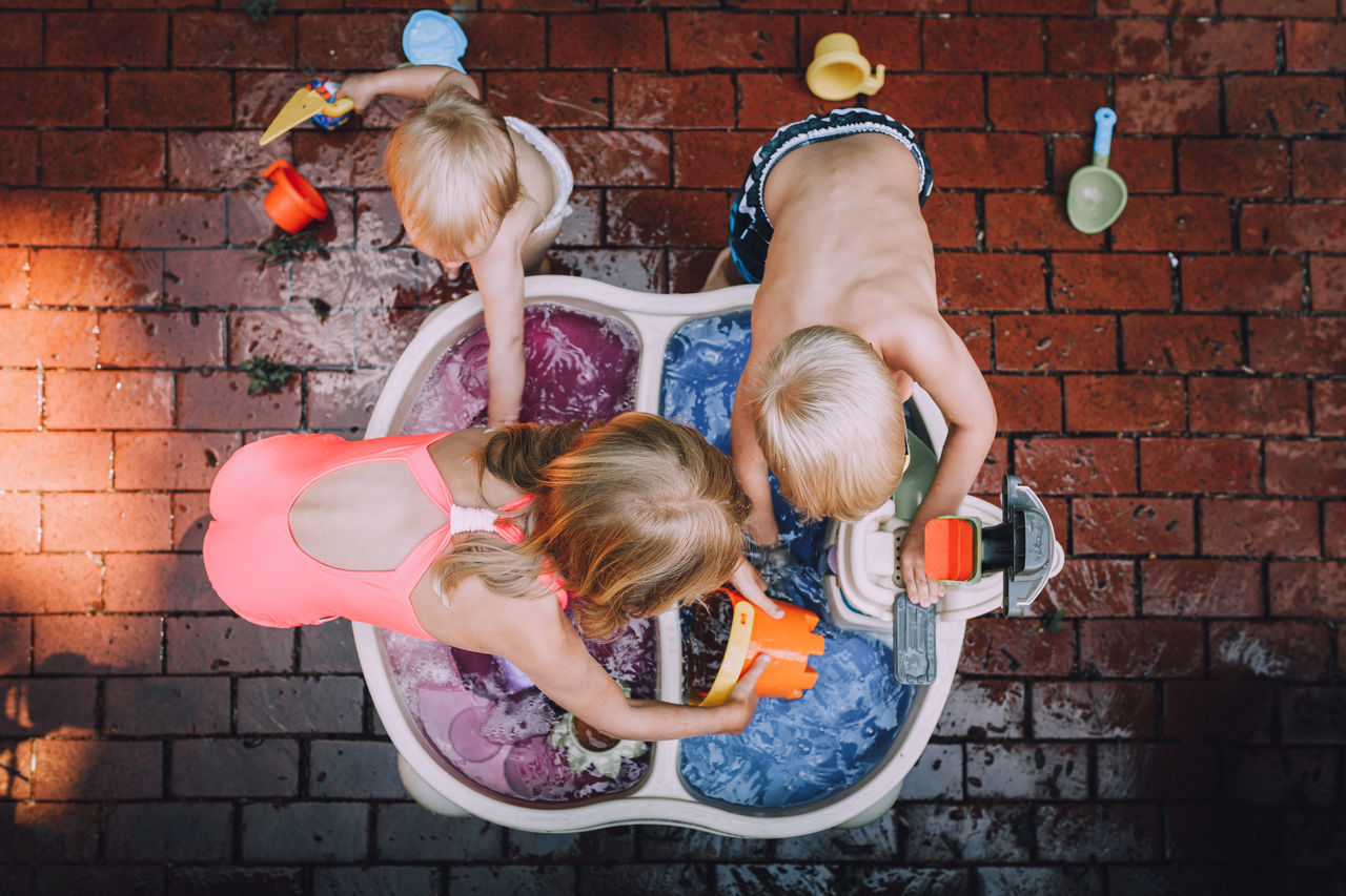 Directly above shot of siblings playing with water