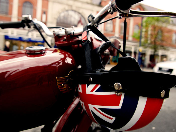 Best of British Mode Of Transportation Transportation Land Vehicle Focus On Foreground City Stationary Bicycle Close-up Red Day Handle Architecture Motor Vehicle Car No People Street Handlebar Travel Motorcycle Wheel British Flag Vintage Motorcycle Vintage Motobikes Helmet HelmetArt Crash Helmet