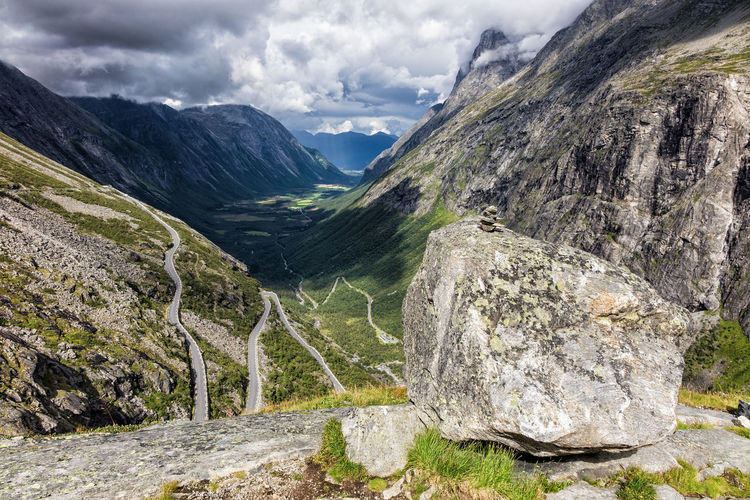Mountains with clouds in Norway. Clouds And Sky Holiday Landscape Mountains Nature Norway Outdoor Road Rocks Sky And Clouds Stones Street Tourism Travel Trollstigen Vacation