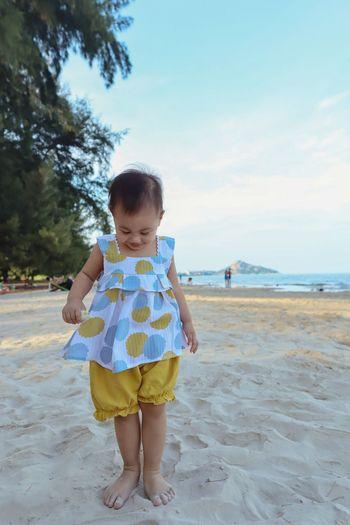 Full length of girl standing on sand at beach