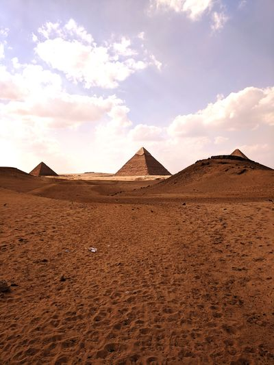 EyeEm Selects Ancient Civilization Desert Pyramid Arid Climate Sand Ancient Mountain History Cultures Pyramid Shape Sand Dune Tomb Old Ruin Civilization Arid Landscape Egyptian Culture Ancient Egyptian Culture Archaeology Mausoleum Grave