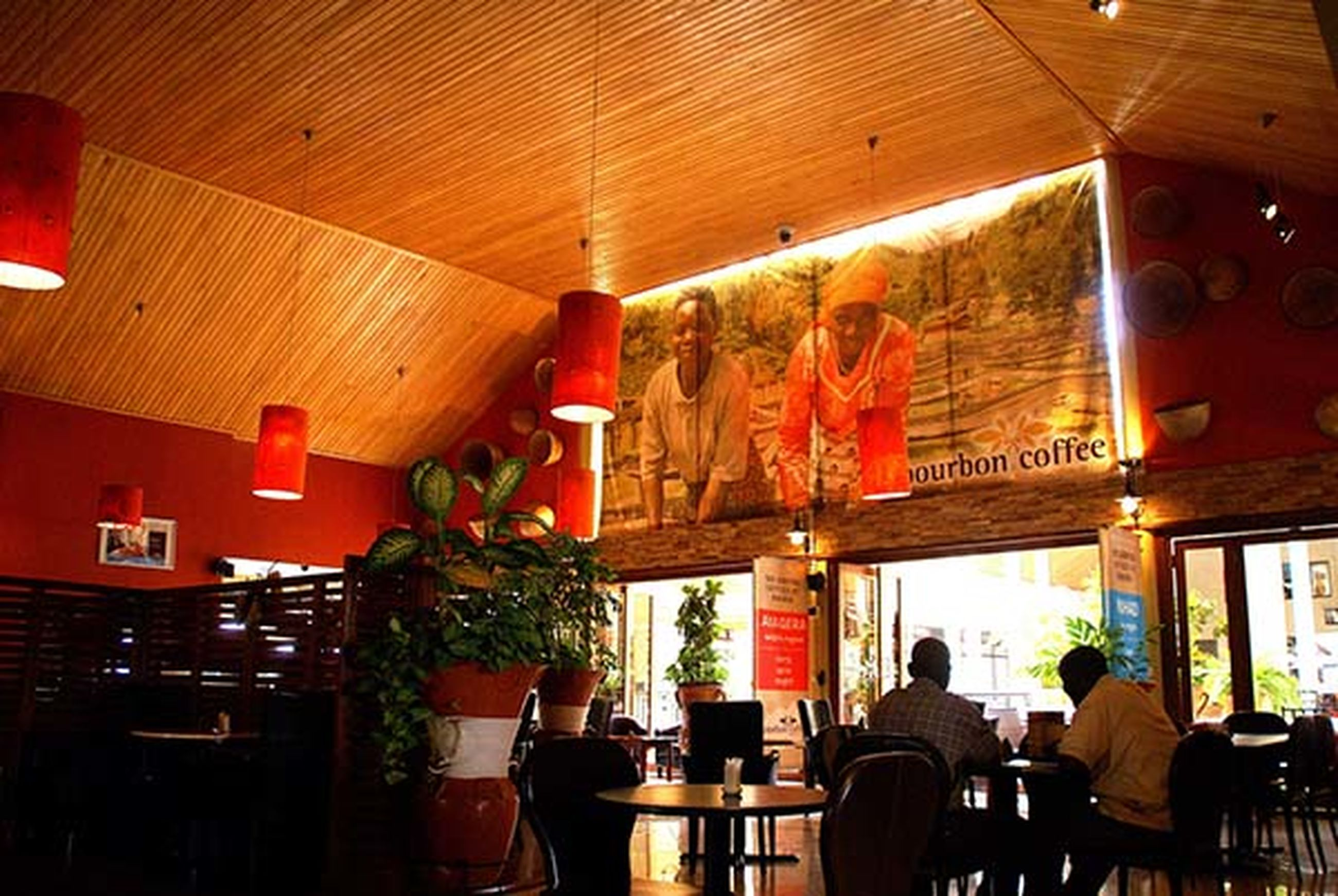 indoors, table, men, chair, cafe, food and drink, preparation, lifestyles, leisure activity, food and drink industry, culture, ceiling, person, restaurant, party - social event, red, place setting, arrangement, nightlife, stage - performance space, bar - drink establishment, dining