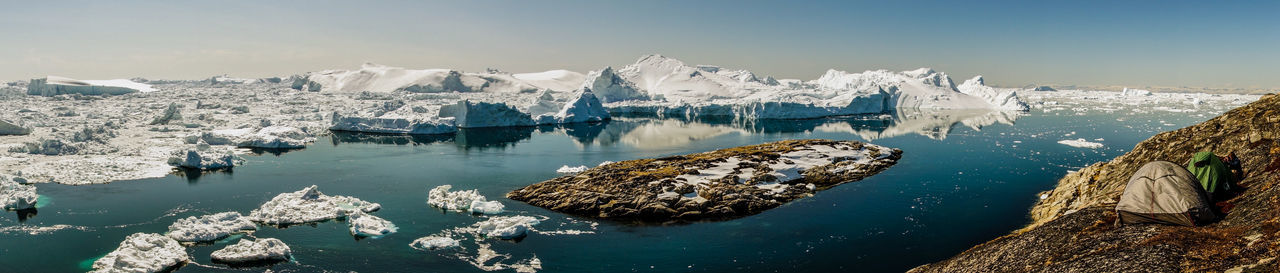 Ilulissat in Greenland offers some of the most impressive iceberg landscapes with easy access right from town. We could even set up our tents there and it is probably one of the best camp sites in my life! Camping Campsite Greenland Icebergs Ilulissat Panorama Ice Berg Iceberg Iceberg - Ice Formation Indoors  Tent Water
