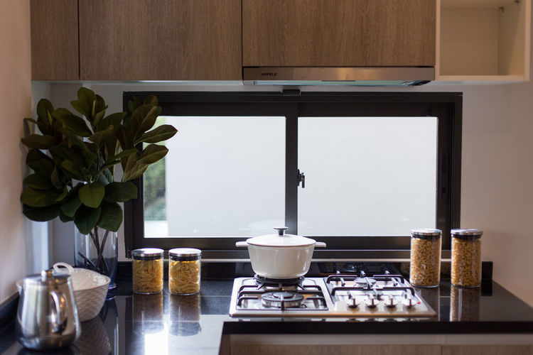 Detail of a kitchen room. Table Indoors  Food And Drink No People Domestic Room Home Still Life Plant Cup Flower Vase Flowering Plant Appliance Nature Coffee Maker Food Home Interior Freshness Mug Day Preparation  Glass Coffee Pot Crockery Pot