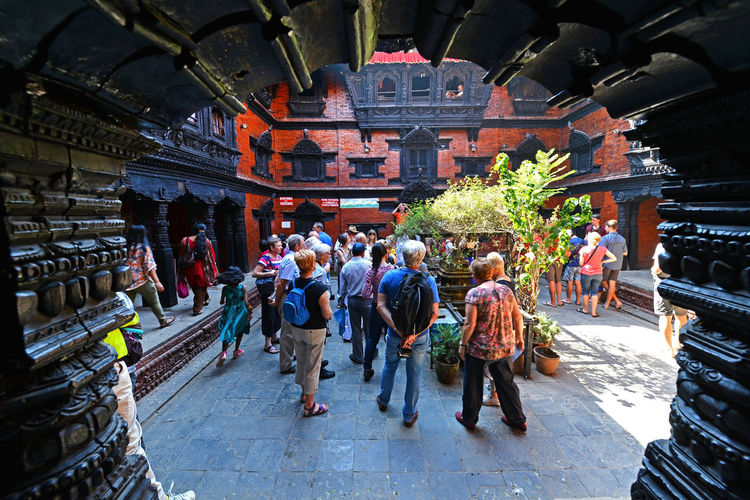 KATHMANDU, NEPAL - SEPT 28, 2013: Tourists visiting the inner courtyard of the living Goddess Kumari. Kumari is believed to be a host for the goddess Durga. Hindu Inner Courtyard Kathmandu Kathmandu, Nepal Kumari Nepal Nepalese Tourists Worship Architecture Building Exterior Built Structure Courtyard  Heritage Hindu Goddess Holy Living Goddess Living Godess Kumari Of Nepal People Place Of Worship Real People Reincarnation Religion Spirituality Visiting