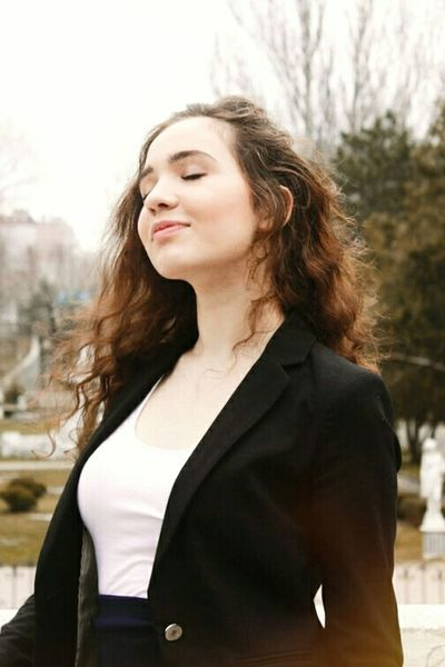 One Woman Only Only Women Long Hair People Women Smiling City Life Young Adult Portrait Outdoors Nature Russia Day Happıness Reflection Sky