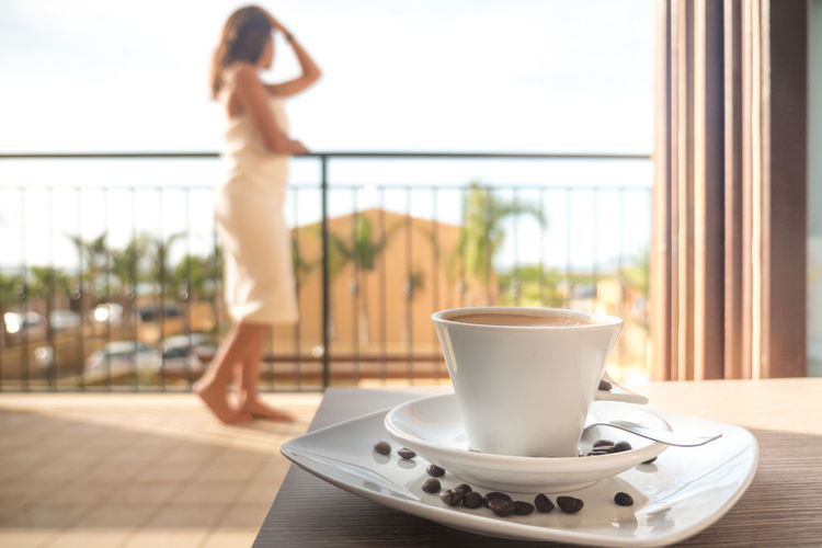 Adult Adults Only Balcony Coffee Day Drink Food And Drink Hotel Indoors  Leisure Activity One Person One Woman Only One Young Woman Only Only Women People Vacations Waking Up Water Window Young Adult