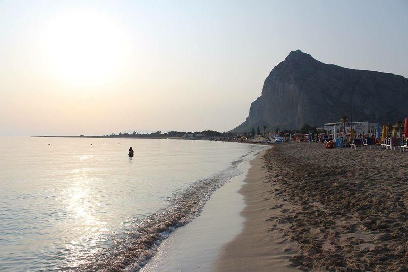 Italy Sicily, Italy Sea Sky Sea Water Beach Land Beauty In Nature Nature Scenics - Nature Clear Sky Crowd Sunlight Mountain Sand Sun Leisure Activity Lifestyles