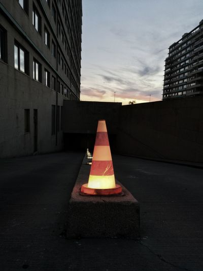 Street light on road against buildings in city
