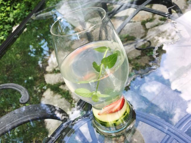 Water with mint, cucumber and sliced strawberry detox water, fruit infused flavored water outdoors on patio table with reflection of sky Healthy Eating Healthy Lifestyle Diet Fitness Diet & Fitness Strawberry Cucumber Cucumber Water Refreshment Drinking Glass Glass - Material Drink Food And Drink Freshness No People Leaf Drinking Straw High Angle View Day Table Water Outdoors Fruit Cocktail Mint Leaf - Culinary Close-up Tonic Water