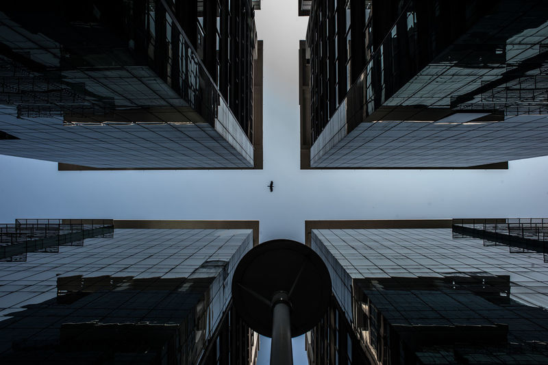Directly below shot of office buildings against sky