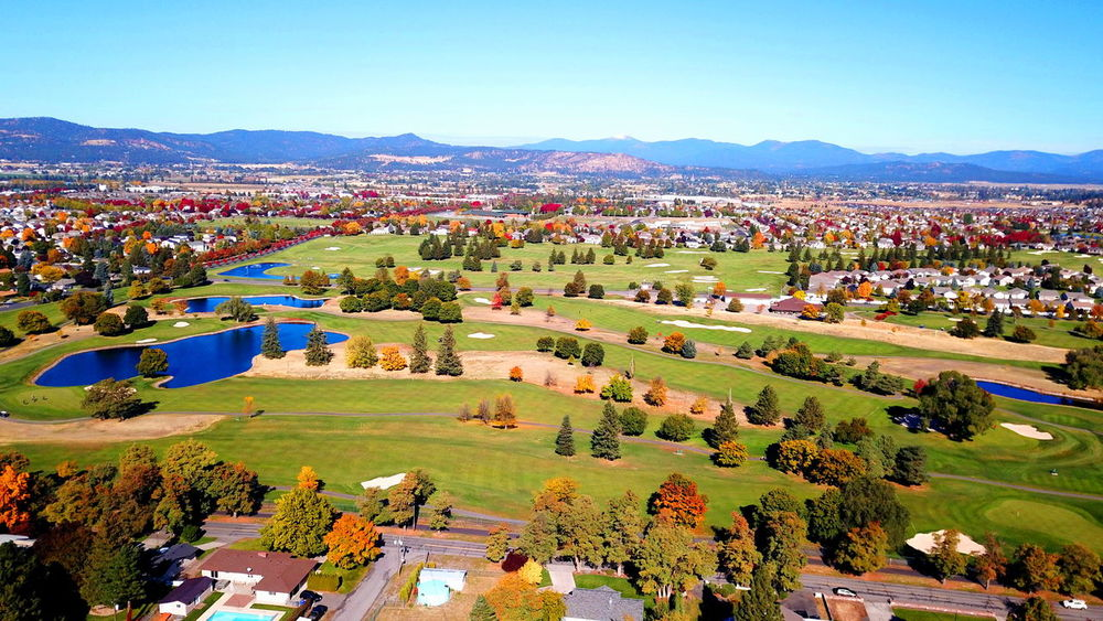 Overlooking the golf course in Liberty Lake. Aerial View Beauty In Nature Blue Day Fall Field Golf Course High Angle View Landscape Mountain Mountain Range Nature Outdoors Scenics Sky Town Tranquility Tree