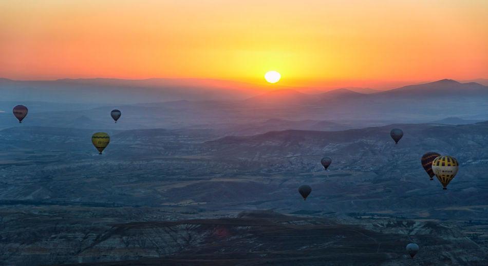 Adventure Ballooning Festival Beauty In Nature Day Extreme Sports Flying Hot Air Balloon Landscape Mid-air Nature No People Outdoors Parachute Scenics Sky Sun Sunset Transportation