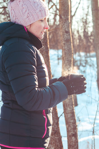 Woman With Hot Drink In Winter Forest