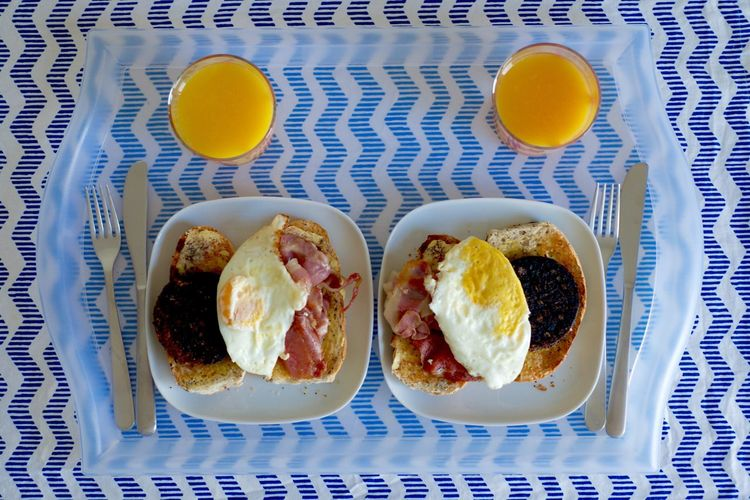 My Favorite Breakfast Moment is the one I get to make for @smellissa. Fried Egg Bacon! Black Pudding Orange Juice  Symmetry Lazy Day Breakfast In Bed Table Cloth Top Perspective Knife And Fork Couple Brunch Two Is Better Than One ShareTheMeal Beautifully Organized Food Stories