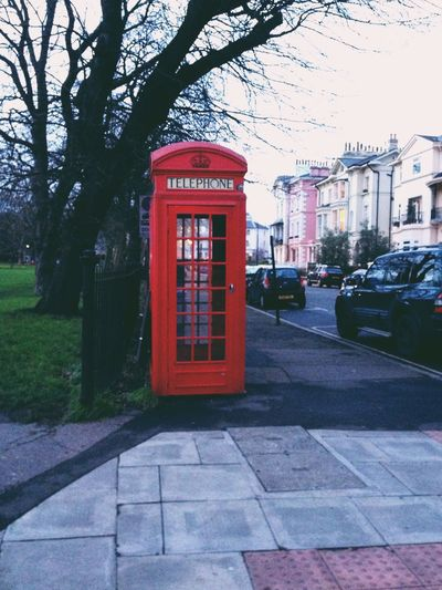 Communication Telephone Booth Telephone Pay Phone Tree Red Connection Outdoors City Built Structure Day Text Telecommunications Equipment No People Cultures Building Exterior Architecture london