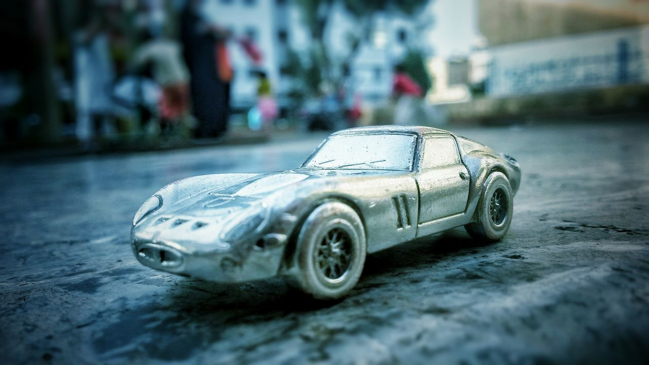 car, toy car, land vehicle, day, no people, close-up, outdoors