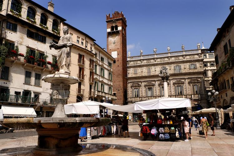 The market stalls in the Piazza delle Erbe in Verona, Italy Historical Building Travel Photography Adult Architecture Building Building Exterior Built Structure City Clear Sky Crowd History Large Group Of People Lifestyles Market Men Outdoors Piazza Piazza Delle Erbe Real People Tourist Destination Travel Destination Travel Destinations Urban Vacation Destination Women