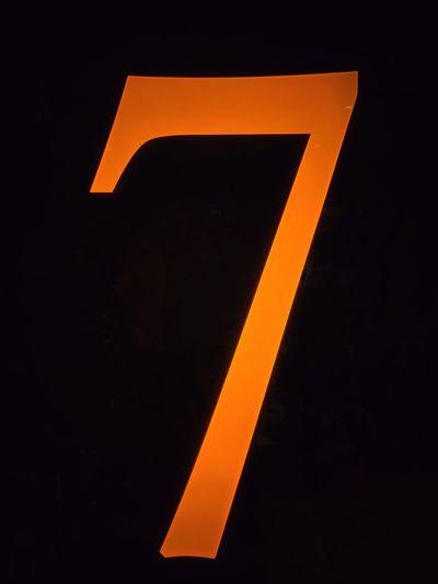 Number 7 Number Sign Orange Color Guidance Communication Arrow Symbol No People Direction Symbol Black Color Night Yellow Close-up Information