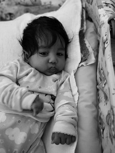 High Angle View Of Cute Baby Girl Lying In Crib
