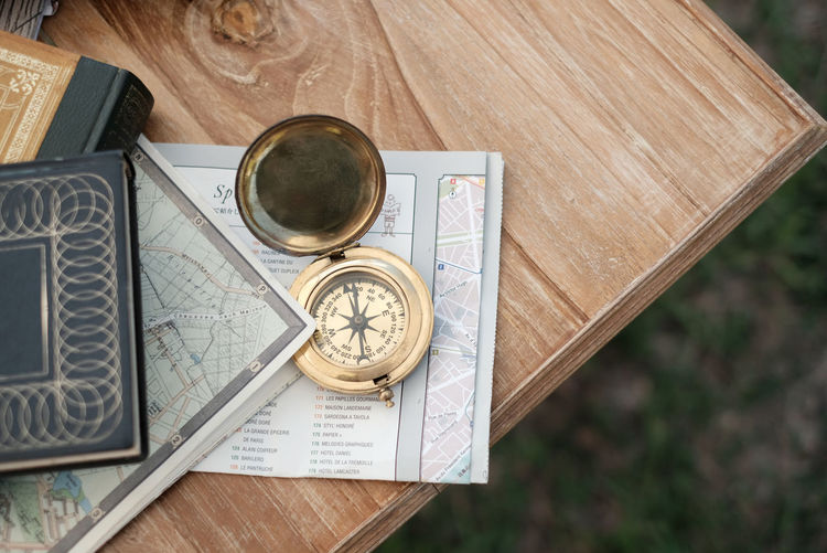 Book Books Camping Close-up Compass Day Diary Directly Above Guidance High Angle View Indoors  Learning Lifestyles Navigational Compass No People Outdoors Table Wood - Material Wooden