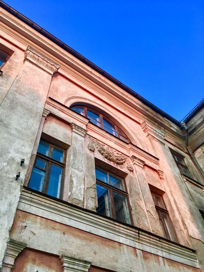 Architecture Built Structure Building Exterior Low Angle View Sky Window Building Outdoors Nature Clear Sky Residential District No People Day House Sunlight Façade Glass - Material Blue Old Wall