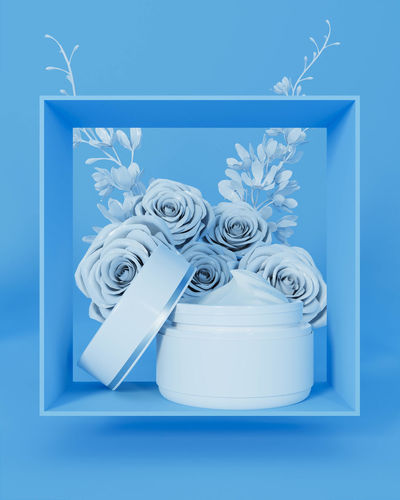 Close-up of white flowers against blue background