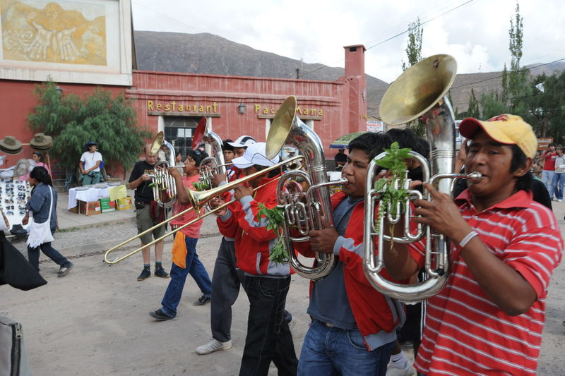 Andes Dancing Music Adult Architecture Argentina Arts Culture And Entertainment Building Exterior Built Structure City Day Large Group Of People Leisure Activity Men Music Musical Instrument Musician Outdoors People Performance Playing Real People Saxophone Tilcara Togetherness Trumpet Wind Instrument