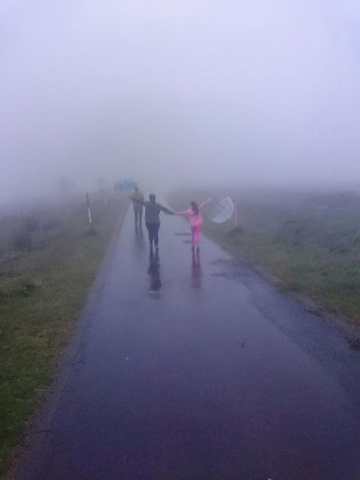Woman standing in foggy weather