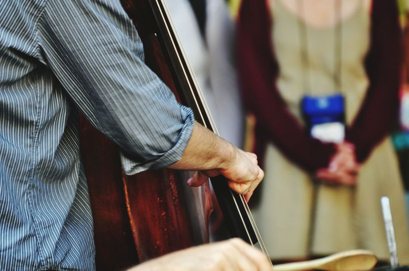 Close-up of man playing cello