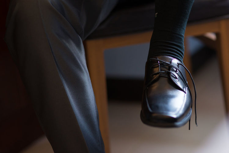 black shoes Black Shoes Wearing Slip On One Person Human Body Part Indoors  Low Section Body Part Adult Standing Midsection Human Leg Shoe Men Focus On Foreground Close-up Women Lifestyles Business Fashion Seat Real People Leather Human Foot Human Limb