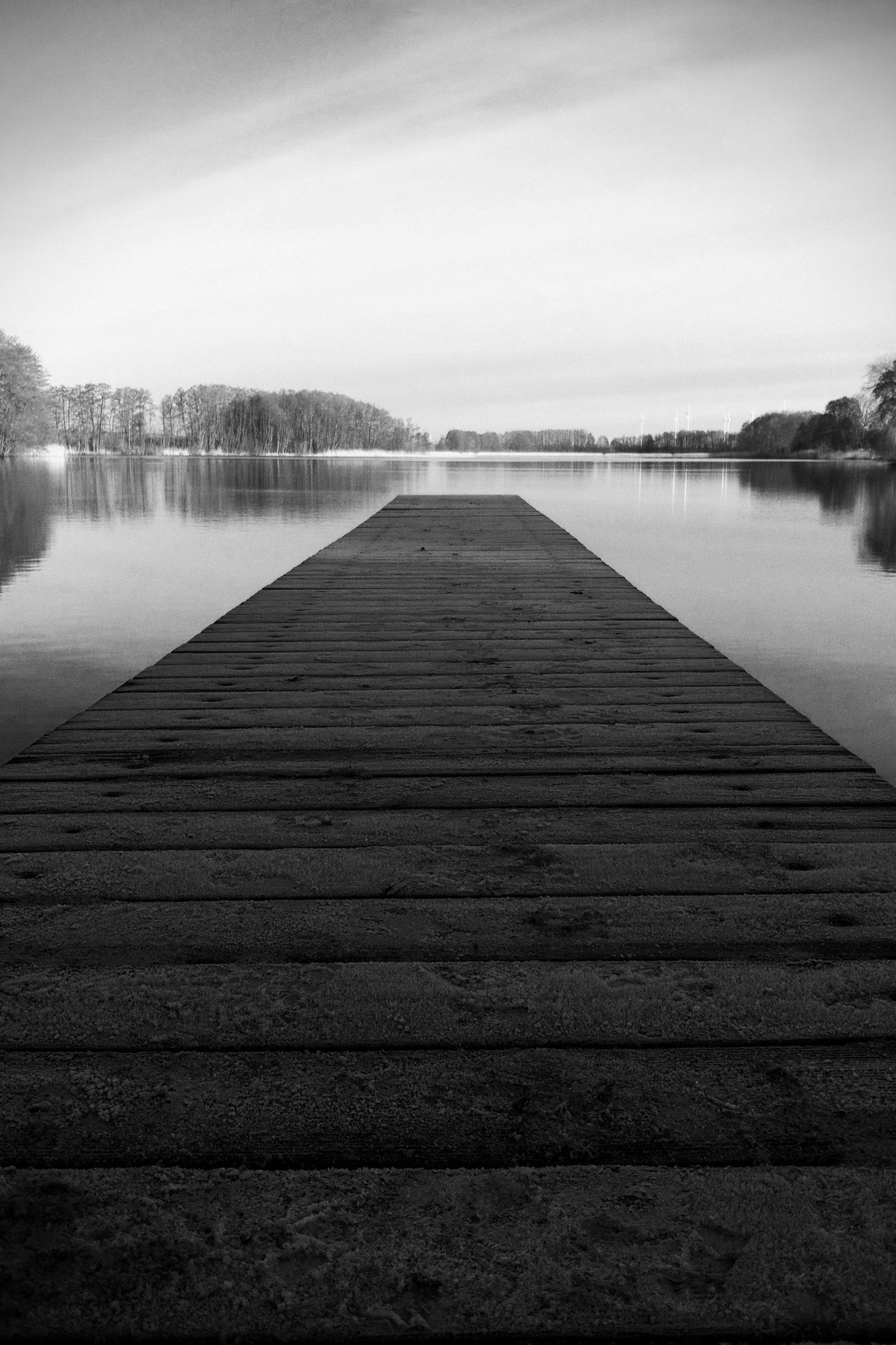 water, lake, pier, the way forward, sky, reflection, tranquil scene, tranquility, wood - material, jetty, diminishing perspective, river, built structure, nature, scenics, boardwalk, beauty in nature, wood, no people, day