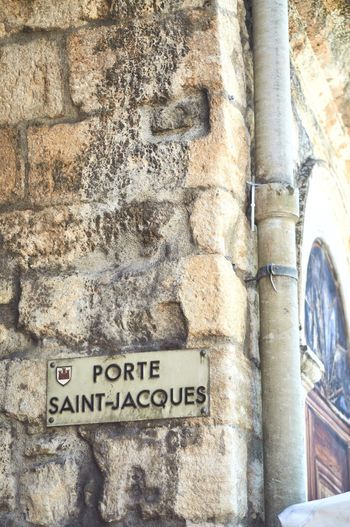 """Porte Saint-Jacques"" Text Western Script Built Structure Architecture Low Angle View Communication Day No People Outdoors History Building Exterior Ancient Close-up Street The Week On EyeEm EyeEm Gallery From My Point Of View EyeEmNewHere EyeEm Best Shots NOMAD Occitanie Provence Nyons"