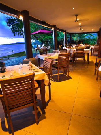 Romantic Dinner for Two Beach View Port Vila Vanuatu Romantic Dinner Absence Arrangement Beach Sunset Chair Dinner For Two Empty Evening Meal No People Pacific Ocean Resort Stars At Night Table Tropical Paradise Under The Stars View Of Water