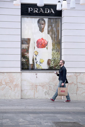 Prada vs Levi's Street Photography Street Photo Streetphoto_color Walking Man Brand Levis Prada Store Store Window Streetphotography City Portrait Boys Standing Sidewalk Mid Adult Building Exterior Window Shopping Boutique Shopaholic Shopping Mall Mannequin Department Store The Traveler - 2019 EyeEm Awards The Street Photographer - 2019 EyeEm Awards My Best Photo