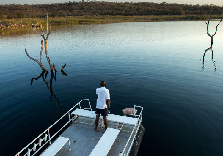 Boat Boat Deck Kariba Nautical Vessel One Man Only One Person People Rear View Tranquility Zambia