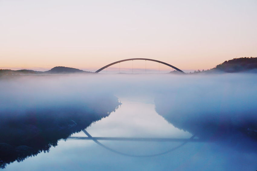 sunset and fog at the Svinesund bridge Sunset Fog Foggy Svinesund Bru Svinesund Norwegian Landscape Norwegianfjords Sunset Fog Reflection Water Bridge - Man Made Structure Business Finance And Industry Tranquility Landscape No People Symmetry Nature Scenics Panoramic Outdoors Horizon Over Water Day Dawn