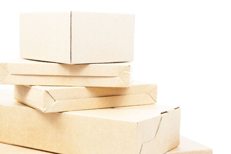 Close-up of boxes over white background