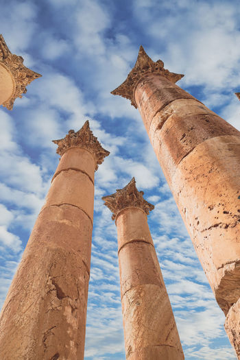 Ancient Architectural Column Architecture Blue Built Structure Cloud Cloud - Sky Cloudy Column Day History Jaresh Jordan Low Angle View Nature No People Old Outdoors Sky Tall Tall - High The Great Outdoors - 2016 EyeEm Awards The Great Outdoors With Adobe The Past Travel Destinations