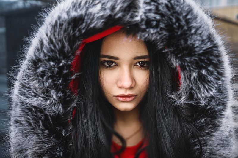 Close-up portrait of beautiful woman wearing fur coat