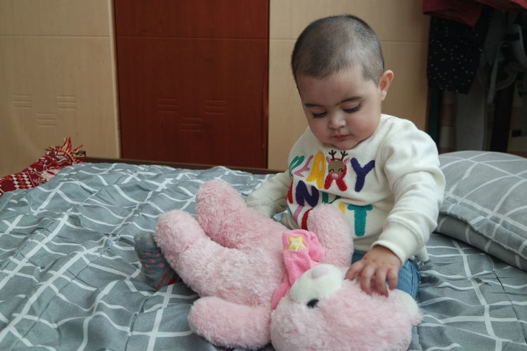 Cute boy playing with toy at home