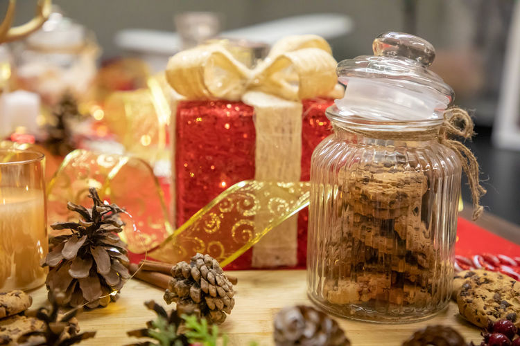 Close-up of christmas decorations in jar on table