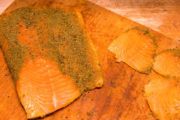 High angle view of fish on cutting board