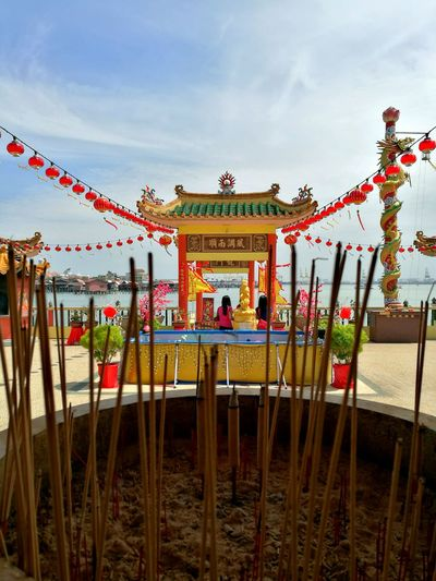 Temple on the sea Adapted To The City Sky Day Temple Temple Architecture Ash Joss Sticks Joss-stick Pot Joss Stick Ash Blue Sky Hot Day Outdoors Pray Praying