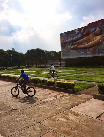 CyclingUnites Outdoors Ciclysts Real People Full Length Day People City Life Building Exterior Cyclist Cycling Time Cycling Around Built Structure Cyclinglife Cycling Trip  Mexico Ciudad Universitaria
