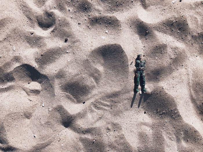 High angle view of an astic soldier on beach