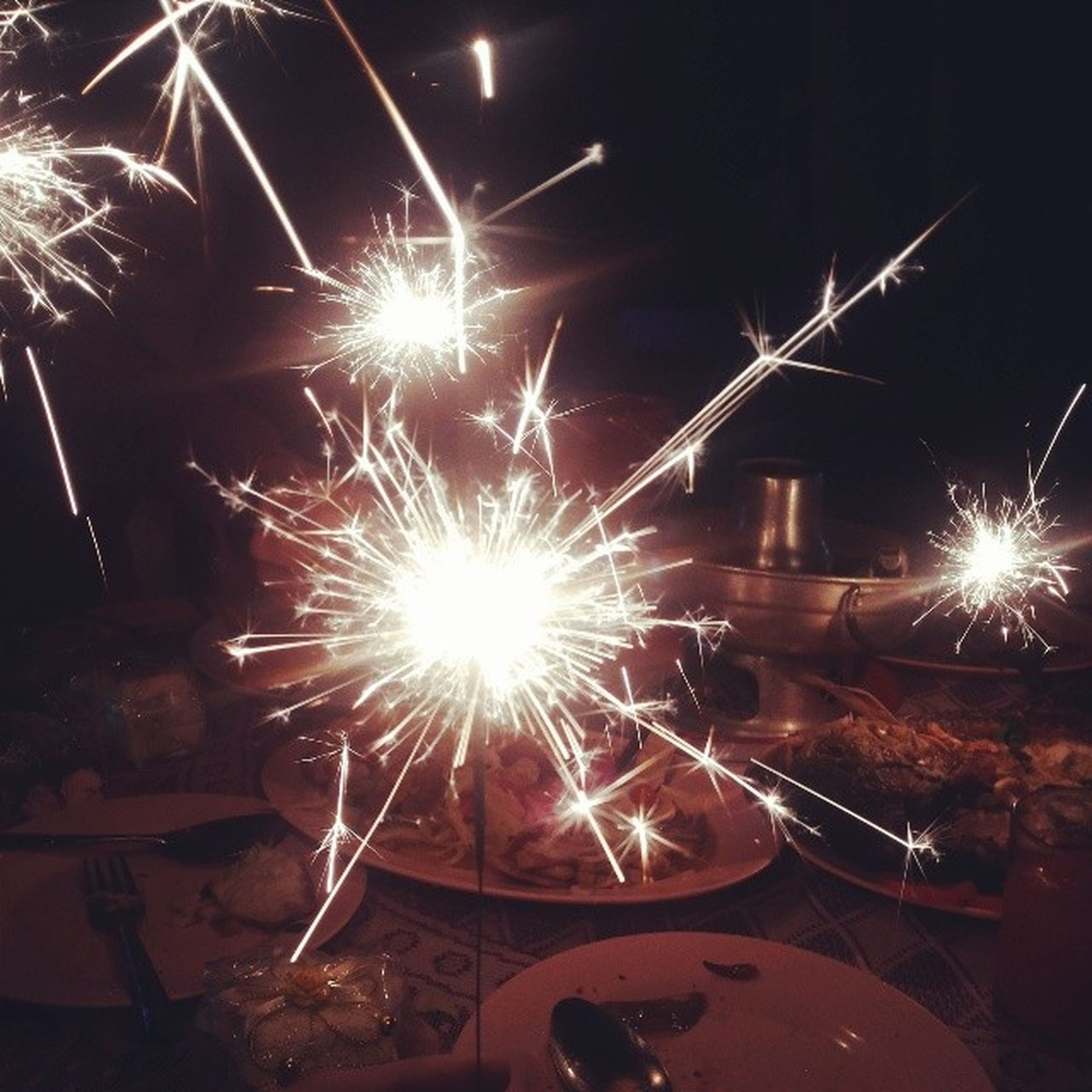 night, illuminated, glowing, fire - natural phenomenon, long exposure, burning, arts culture and entertainment, lighting equipment, motion, light - natural phenomenon, sparks, celebration, dark, exploding, event, flame, firework display, firework - man made object, lit, heat - temperature