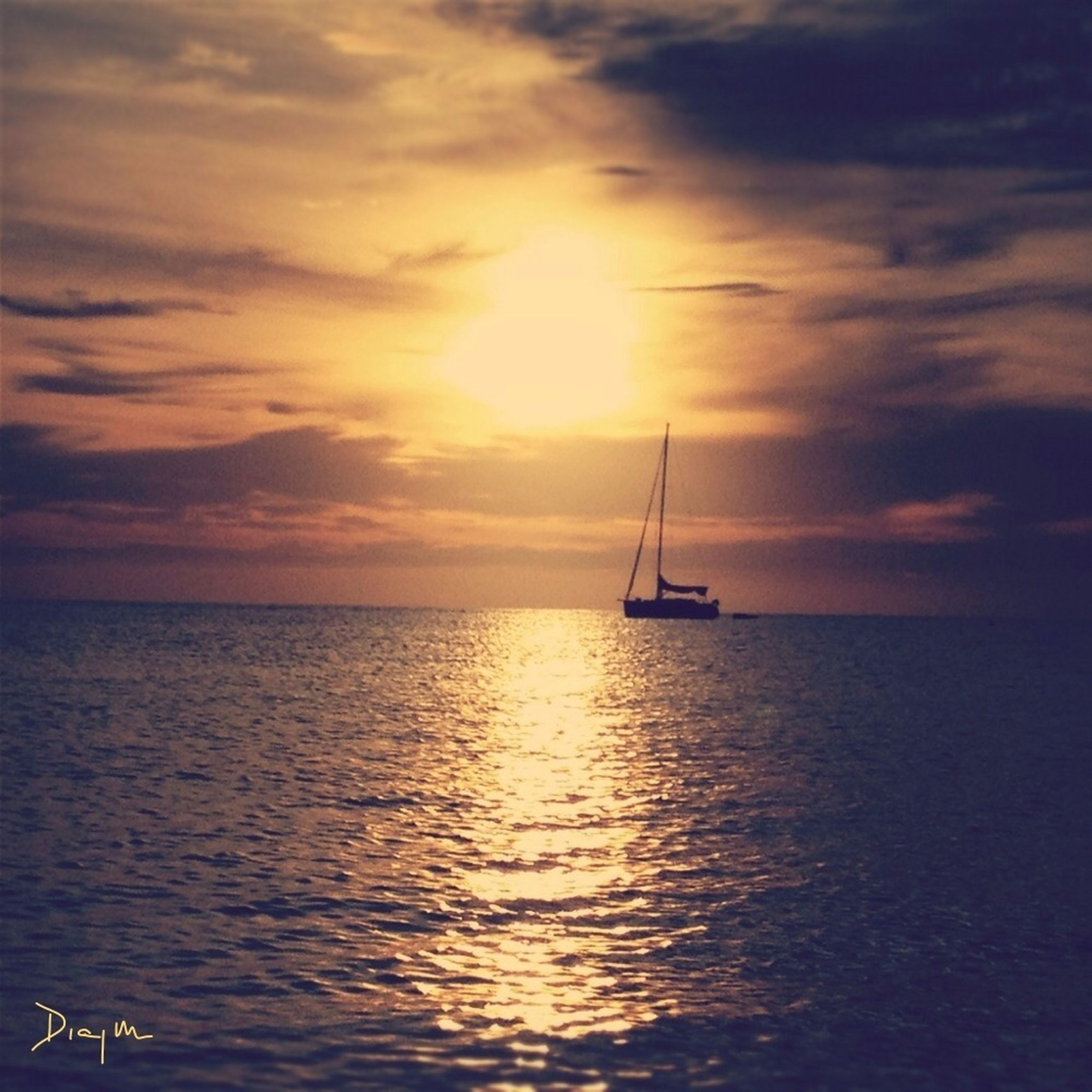 sea, sunset, nautical vessel, water, transportation, mode of transport, sky, boat, horizon over water, scenics, beauty in nature, tranquility, tranquil scene, waterfront, cloud - sky, sailboat, nature, orange color, sun, sailing