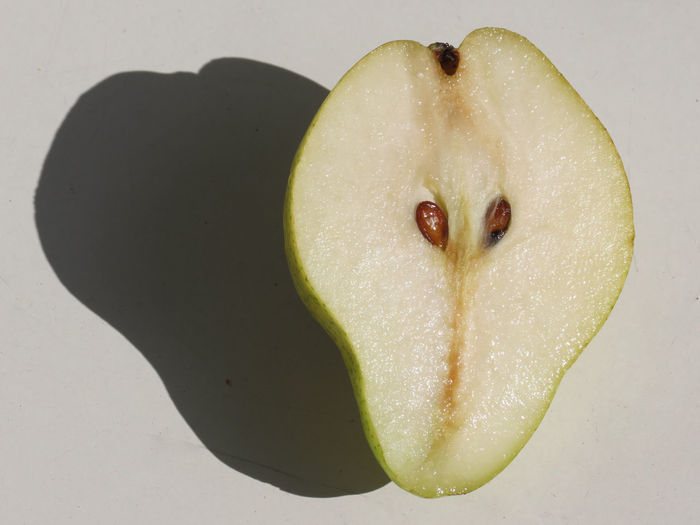 Pear Half Photography September 2017 Brown Cores Close-up Day Flowers Rest Food Food And Drink Freshness Fruit Healthy Eating High Angle View Indoors  Juicy Pear No People Pome Fruit Ready-to-eat Shadow SLICE Studio Shot White Background