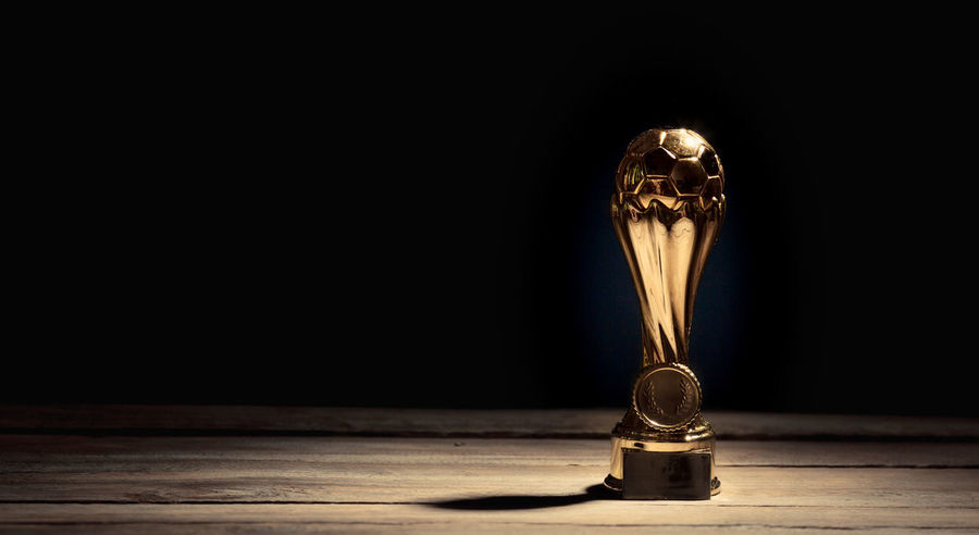 AWARD Achievement Champion Football Master Show Top Trophy Winners Winning Best  Ceremony Championship Cup Gold Colored Indoors  Metaphor No People Presentation Reward Soccer Sports Victory Winner